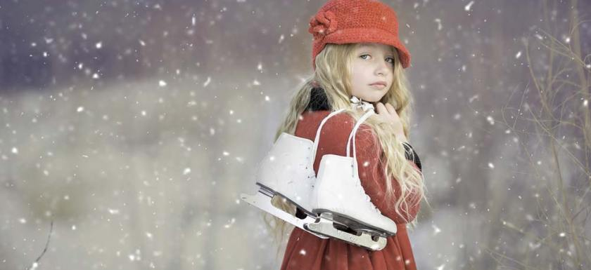 Girl with red coat going ice skating