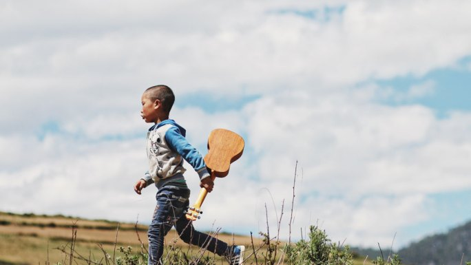 Boy with a Guitar off to Music Lessons