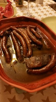 Brisket and sausage in wine