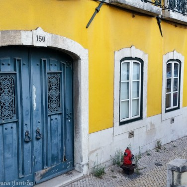 Blue door on yellow house Lisbon