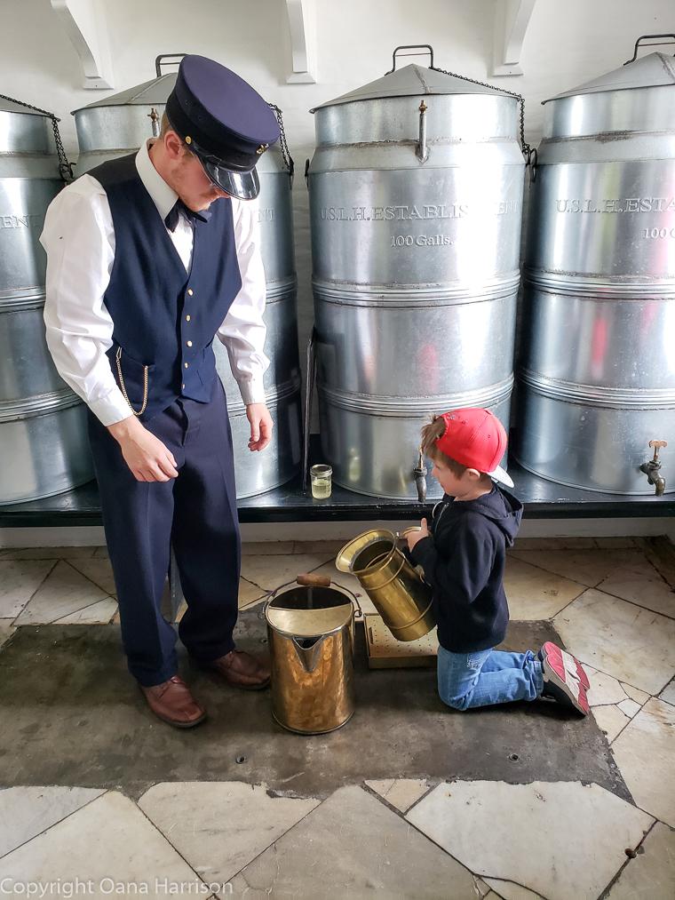 Yaquina-Head-Lighthouse-boy-filling-oil-bucket