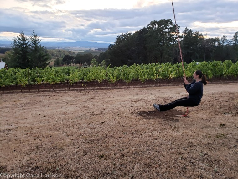 Eola Hills Legacy Winery Salem Oregon Oana swinging past the grapevines