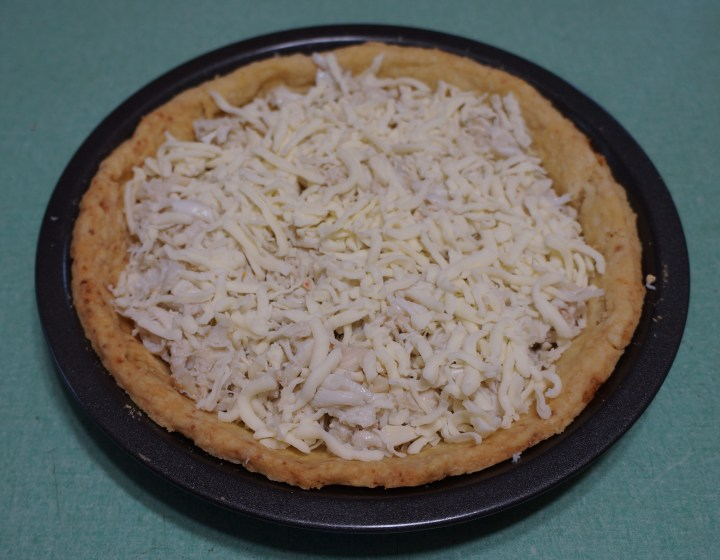 About 1 cup of shredded mozzarella cheese on top of the crab.