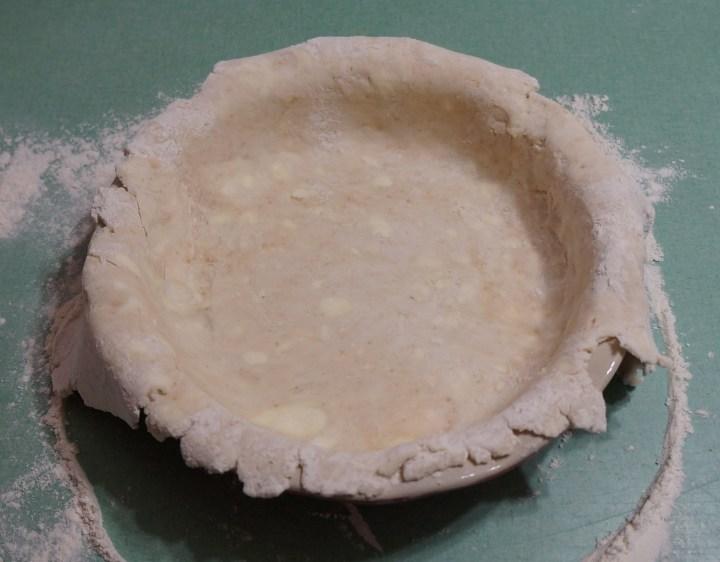 Pie dough transferred to pie plate.