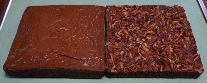 Two competing brownie recipes - cooled and removed from their baking pans - ready for consumption.