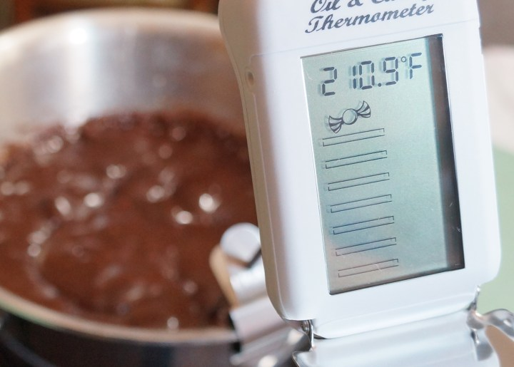 Insert a candy thermometer, making sure the probe doesn't touch the bottom of your saucepan.
