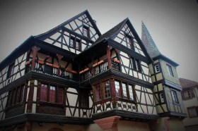 An extravagant house, complete with ornamental carvings and a decorative tower