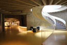 The museum is cut into the hill, and plays beautifully with levels, curves and light to create a wonderful sense of space.