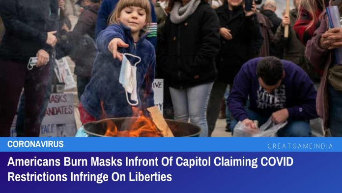 Americans Burn Masks Infront Of Capitol Claiming COVID Restrictions Infringe On Liberties