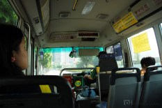 Riding a bus in Macau.