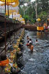 At Tirta Empul, a holy mountain spring can be found at the entrance and the locals usually wash themselves here before going inside to pray.