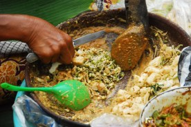 Rujak: a mixture of fruits and vegetables with peanut paste being sold in the streets.