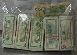 Picture of $27,773 seized from luggage.