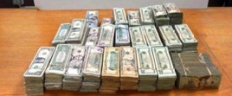 Picture of 24 bundles of unreported U.S. currency totaling $230,753.