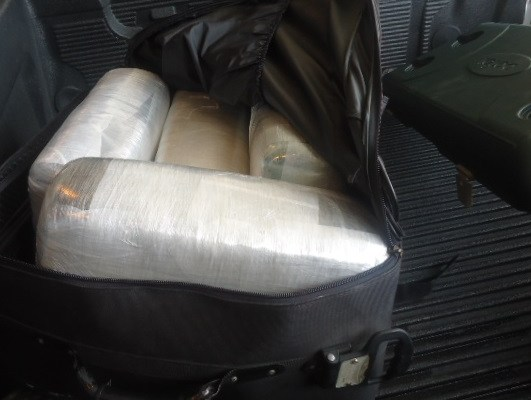Picture from incident where Border Patrol seized cash showing a black bag with vacuum sealed items inside