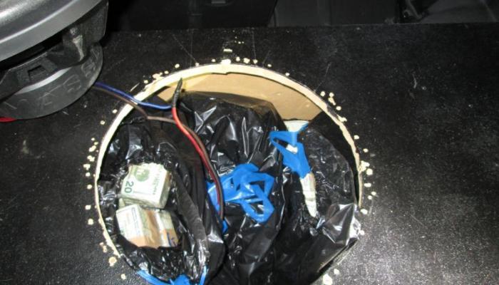 Bags of money stuffed inside a speaker box seized by U.S. Customs