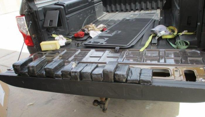 Currency bundles wrapped in black tape were hidden within the tailgate of the truck. The cash was seized by CBP.