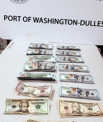 $11097 seized by CBP displayed by Dulles airport CBP