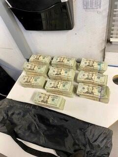 Stacks of bills containing $100,025 in unreported currency seized by CBP officers at Rio Grande City Port of Entry.