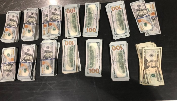 Piles of cash seized by CBP at Detroit Metro Airport