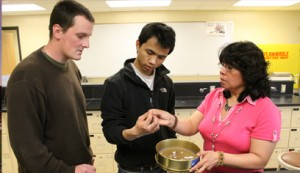 Lorena Rios Mendoza, an assistant chemistry professor at the University of Wisconsin-Superior, with students in her lab examine plastics found on the shore of Lake Superior.