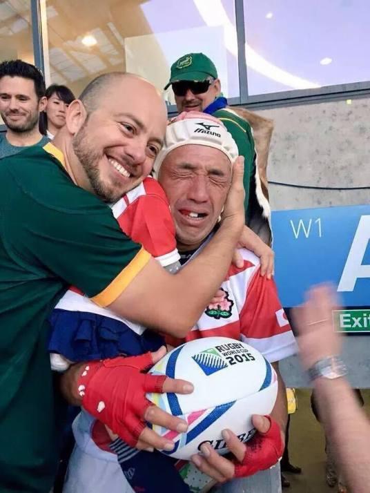 South African fan hugs Japanese fan