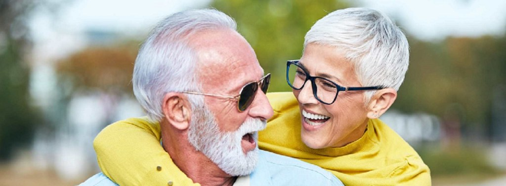 portrait of happy smiling senior couple outdoors