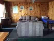 Sitting room and TV in all cabins