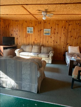 Couches in the living area offer a cozy place to relax, or extra sleeping spots for big groups.