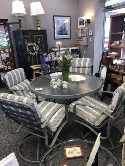 Round outdoor table with 4 padded chairs $275