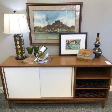 $495 West Elm sideboard. $59 Lamp. $150 Art each. $10 Wine bottle holder. Green wine glasses $10 for the pair. $19 Tall vase
