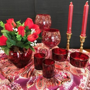 $25 Red patterned wine glasses (Set of 4) $20 Red wine glasses (Set of 6) $20 Brass candlesticks (1 pair) $20 Talbots silk scarf