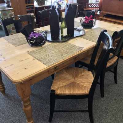 Table and 4 chairs $395, Leather look wine bottle caddies $15 each, Placemats $15 for 8