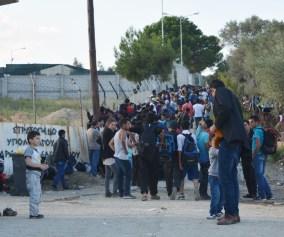 Refugees lining up for transit docs