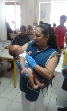 Volunteer with new baby
