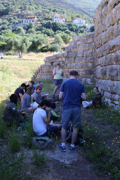 Learning about ancient Messene in the shade behind the theater