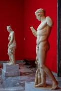 Two marble statues depicting a diadoumenos athlete and Aphrodite