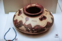 Small ceramic pot with decoration