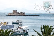 Bourtzi and fishing boats in Nafplio port