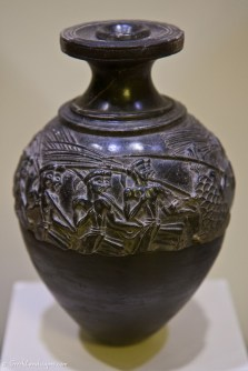 Ceremonial vase with relief carving of men