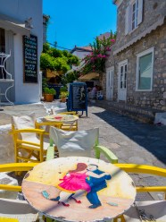 Round table with painting in Hydra town