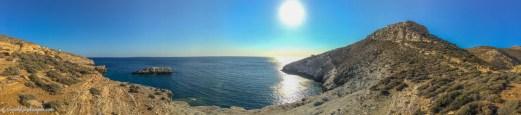 Rugged coastline with blue sea and sun