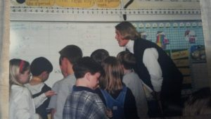 14 year ago me teaching math {shhh, do not comment on the hair}!