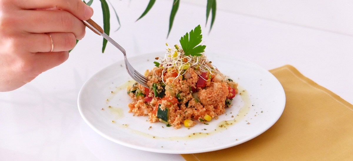 Tabbouleh with raw vegetables and leek sprouts