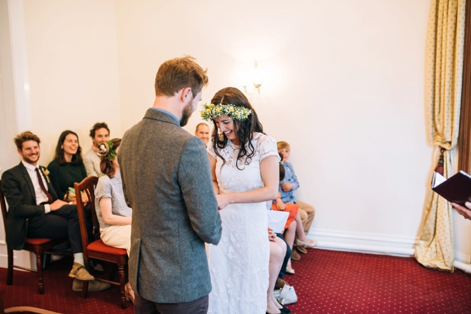 bride and groom exchanging of the rings in HAWARDEN