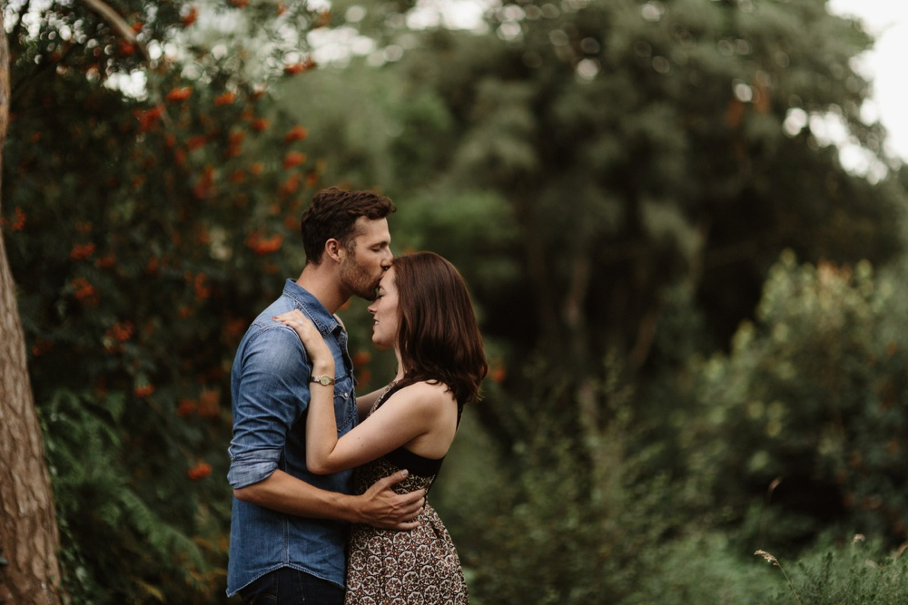 forehead kiss in the park in Summer