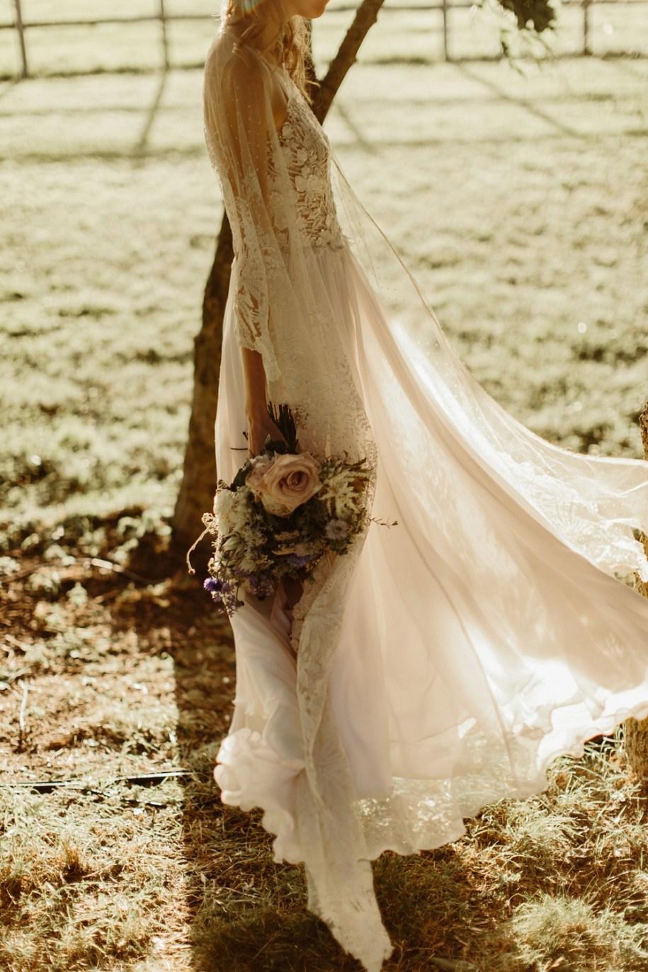 bride at sunset for her garden wedding