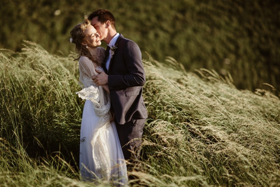 bride and groom laugh for portrait shoot in Oxfordshire