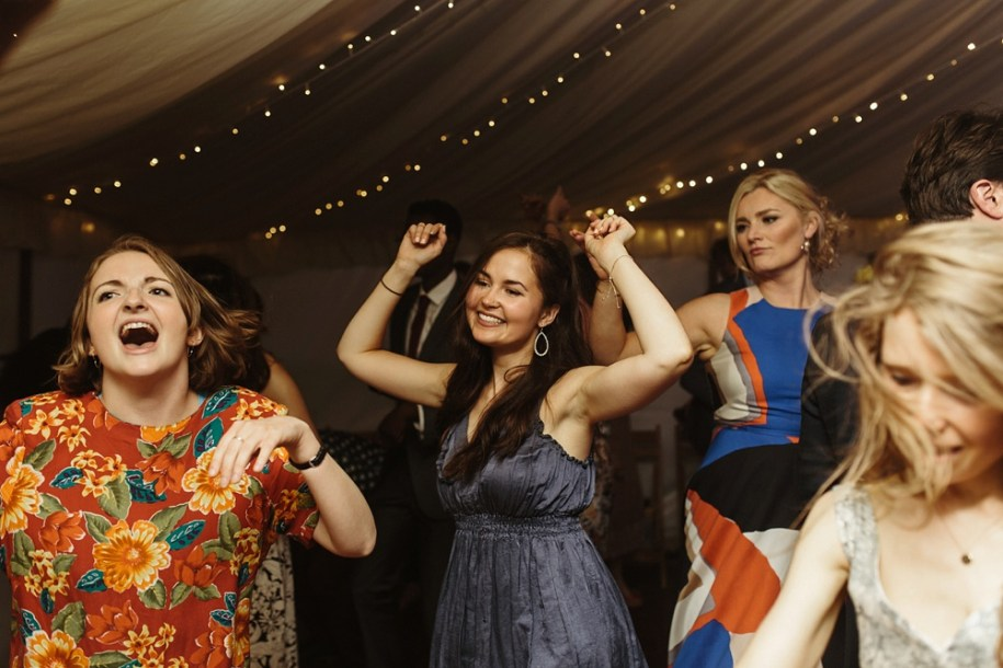 guests having fun and dancing at a marquee wedding