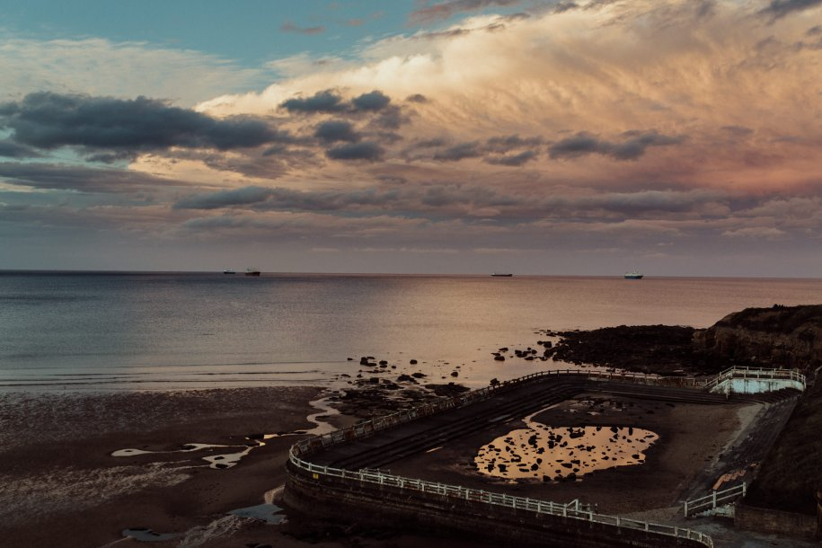 deserted swimming pool during Sunset in Tynemouth
